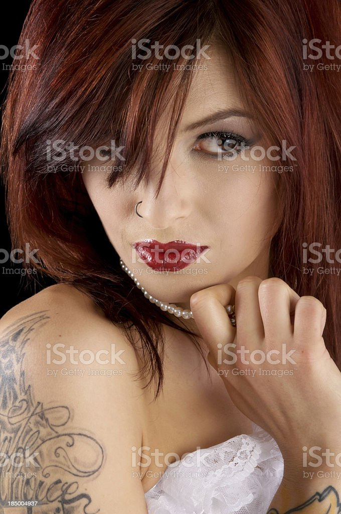 Beauty looking up from under bangs royalty-free stock photo