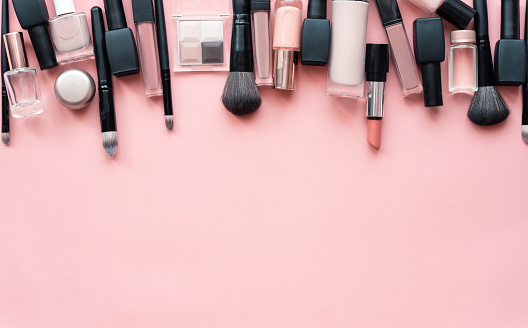 Beauty make up cosmetic women products accessories in line row on pink flat lay background, cheap discount commercial retail sale offer online purchase, top view above copy space, makeup wide banner