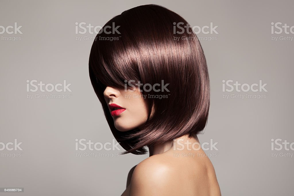 Beauty model with perfect glossy brown hair. Close-up portrait stock photo