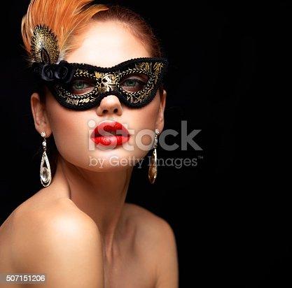 istock Beauty model woman wearing venetian masquerade carnival mask at party 507151206