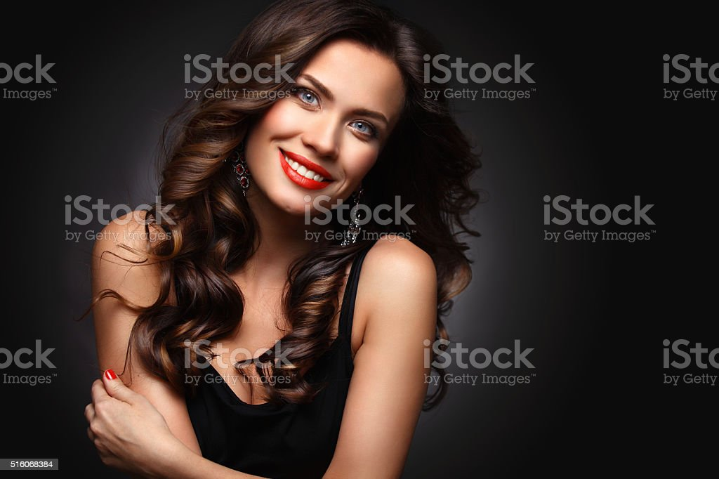 Beauty Model Woman with Long Brown Wavy Hair stock photo