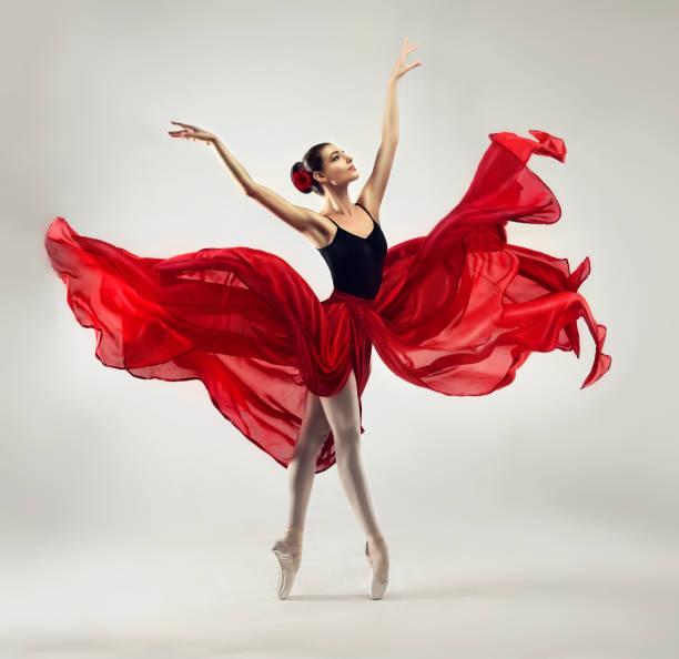 Beauty of classic ballet. Ballerina is performing classic dance. stock photo