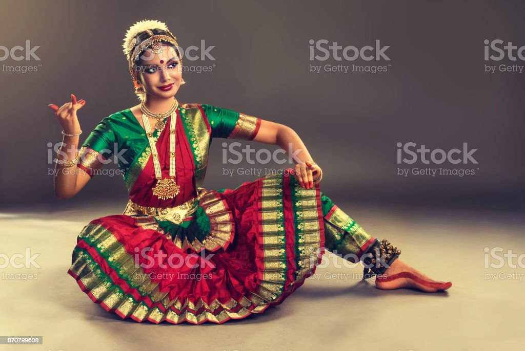 Beauty of classical indian dance. Young woman dancer  is performing indian dance bharatanatyam. stock photo