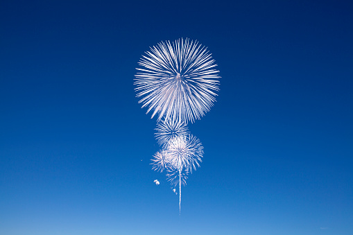 It is a beautiful fireworks shining in the night sky. That light gathers and lightens the person's mind.