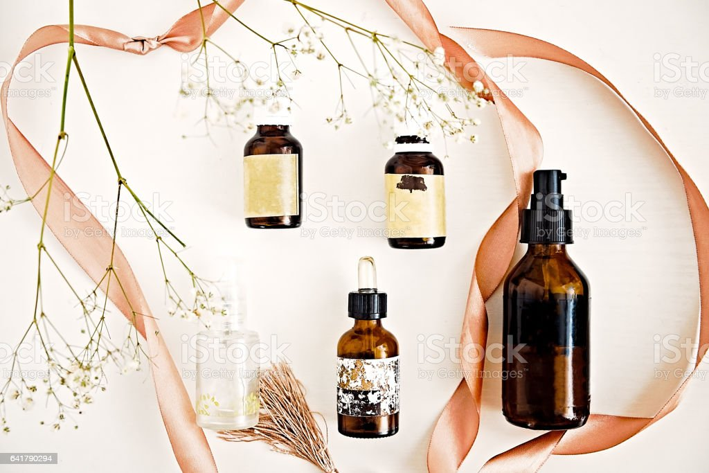 Beauty oils in dark bottles on white stock photo