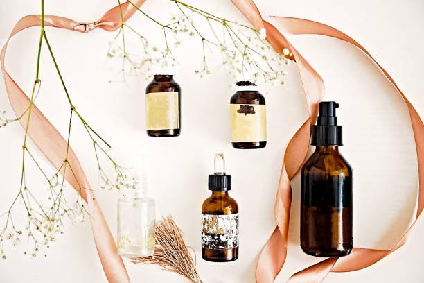 Beauty oils in dark bottles on white stock photo