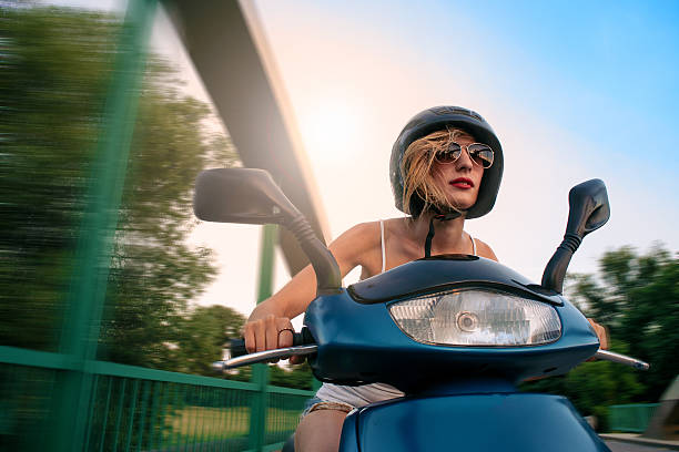 Beauty on scooter. stock photo
