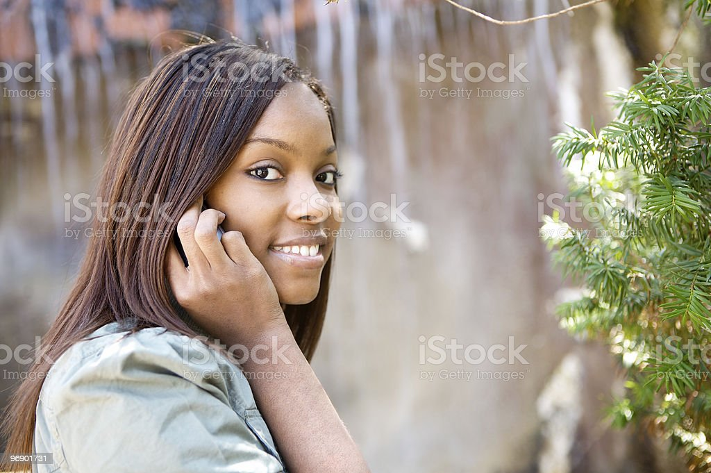 Beauty on the phone by waterfall. royalty-free stock photo