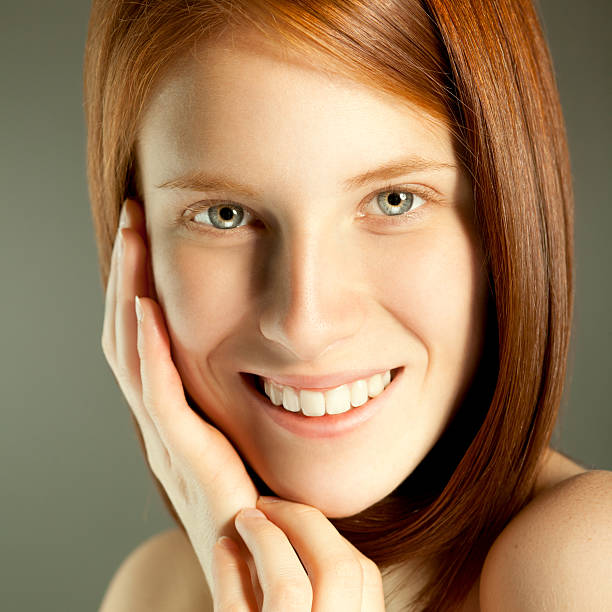 beauty - woman green eyes red hair stock photos and pictures