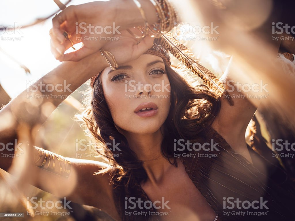 Beauty portrait of a boho girl in afternoon sunlight stock photo