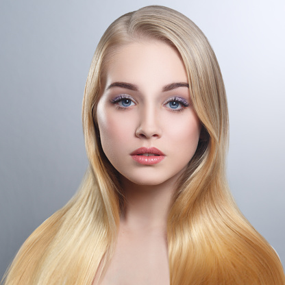 beauty portrait of a cute blonde with long straight hair