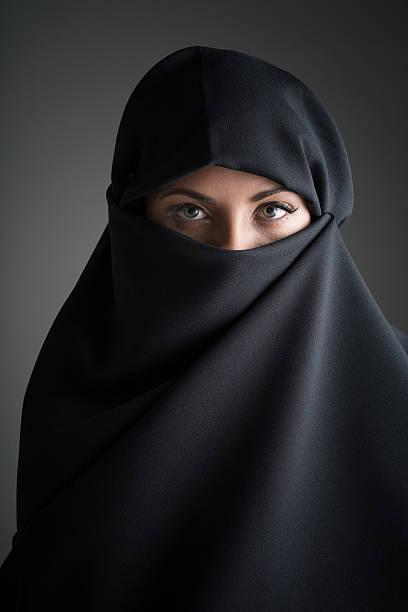 beauty portrait of a muslim woman - burka stock-fotos und bilder