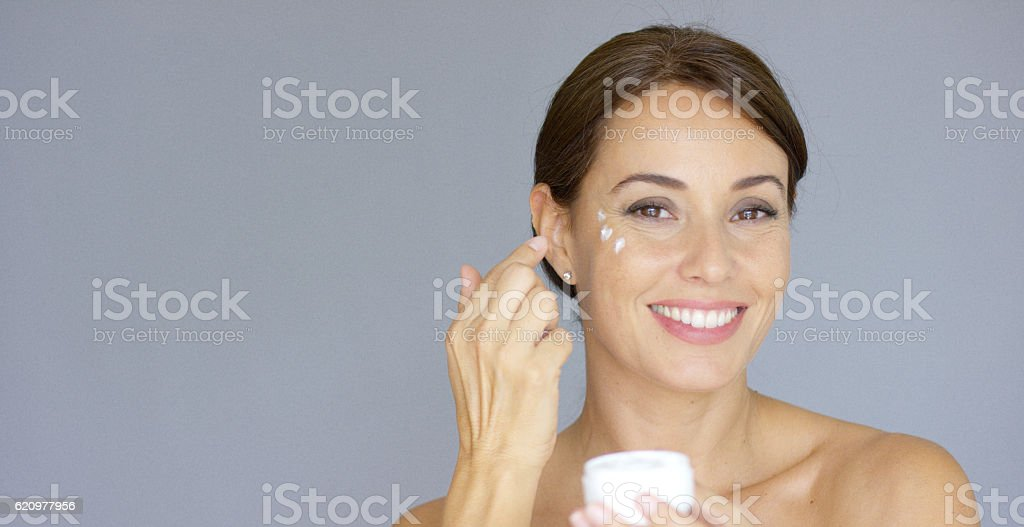 Beauty portrait of a smiling young brunette woman stock photo