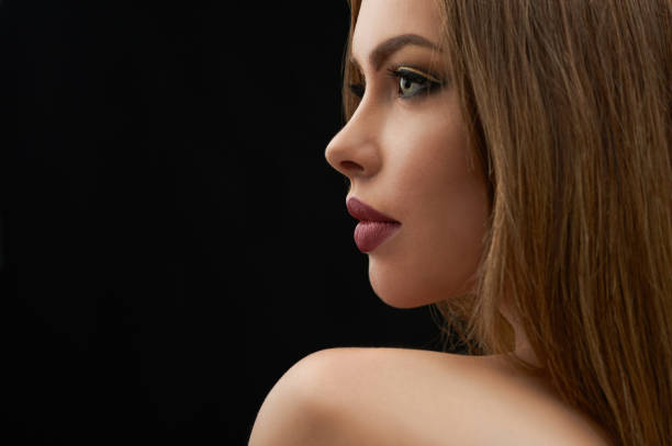 Beauty portrait of a stunning full lipped young woman stock photo
