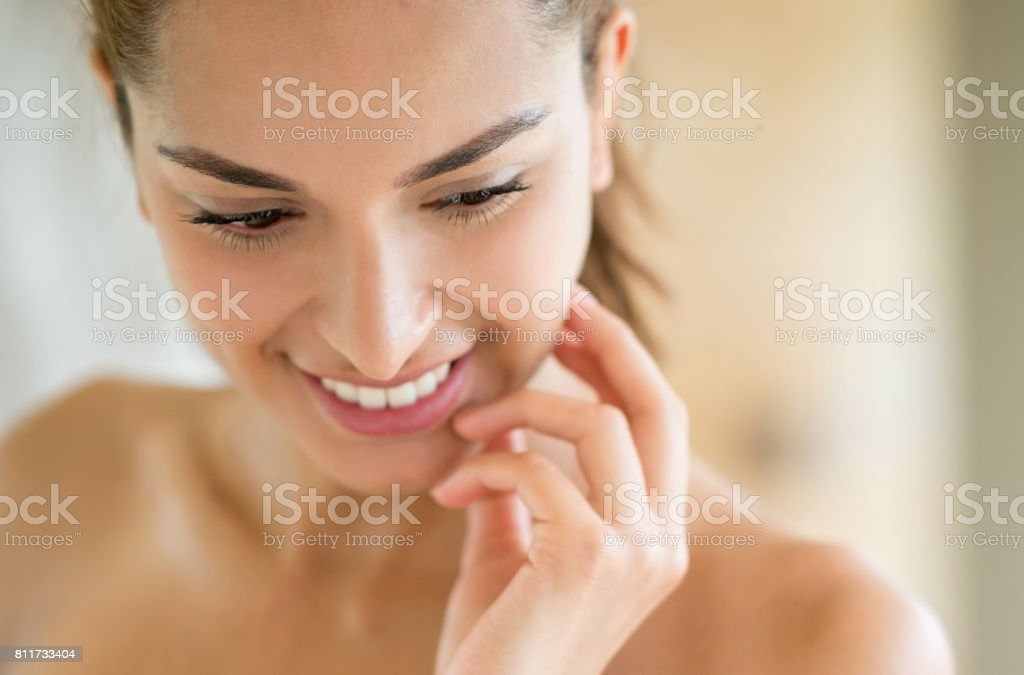 Beauty portrait of a woman in the bathroom stock photo