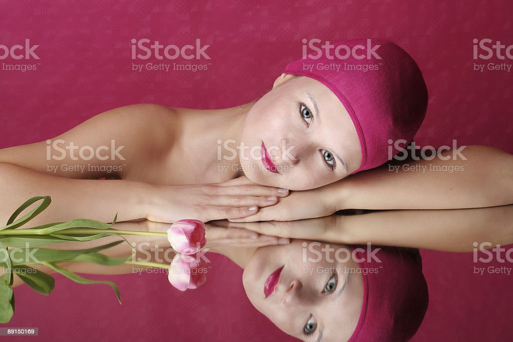 beauty portrait of a woman on mirror with flower royalty-free stock photo