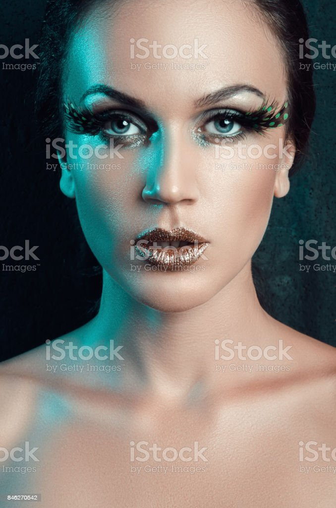 4b5461443bc beauty portrait of a woman with a fake big green eyelashes feather royalty-free  stock
