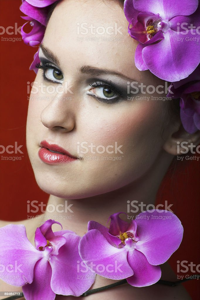 beauty portrait of a woman with orchid flowers royalty-free stock photo