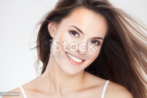 istock Beauty portrait of a young brunette woman with beautiful smile 174755444