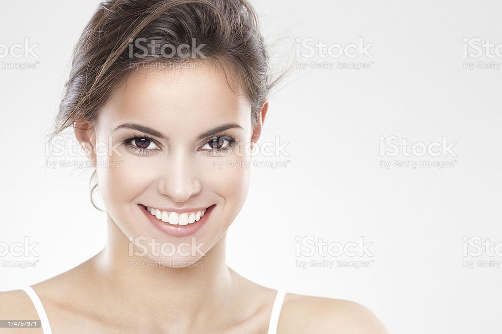 Beauty portrait of a young brunette woman with beautiful smile stock photo
