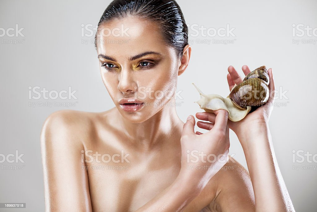 Beauty portrait of a young woman with snail stock photo