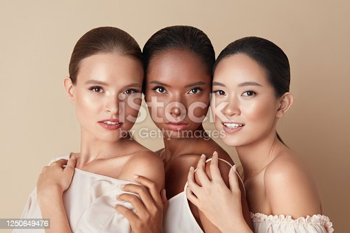 istock Beauty. Portrait Of Diversity Models. Mixed Race, Asian And Caucasian Girls Hugs Each Other And Looking At Camera. Different Ethnicity Women With Nude Makeup And Perfect Glowing Skin. 1250649476