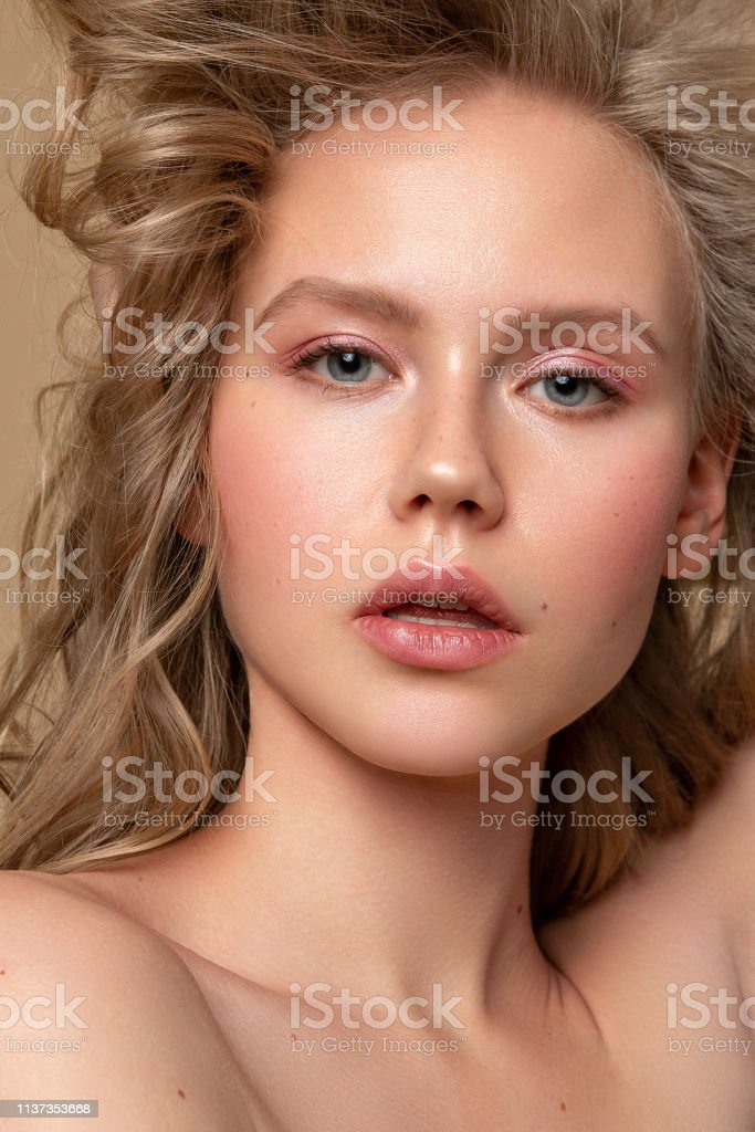 beauty portrait female playing with hair close up pure skin