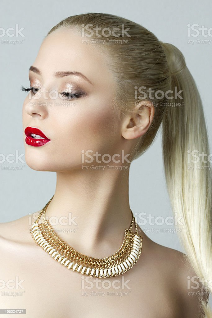 Beauty portrait of gorgeous blonde woman with ponytail stock photo