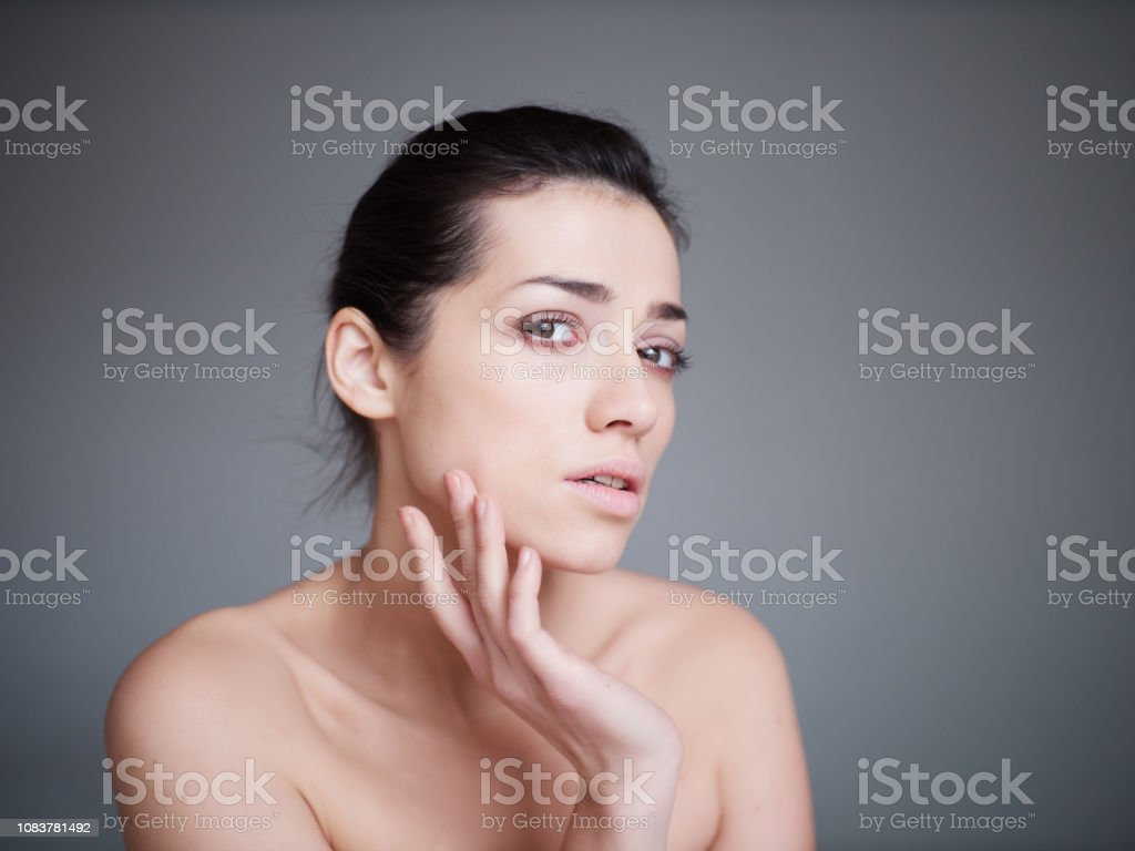 Beauty portrait of healthy female face with natural skin isolated on...