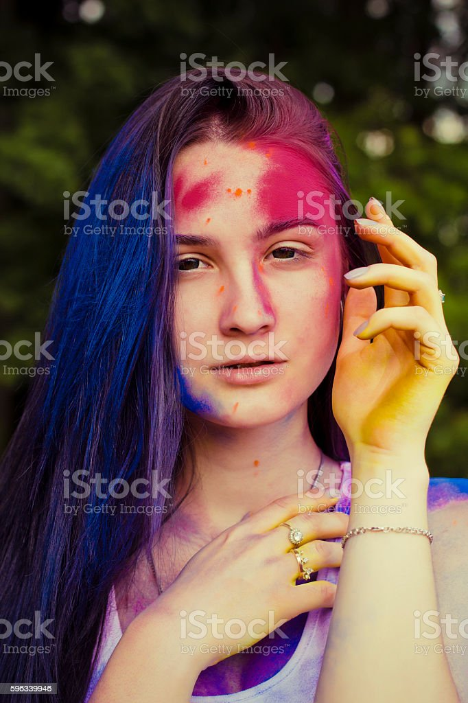 Beauty portrait of  pretty woman with paint holi royalty-free stock photo