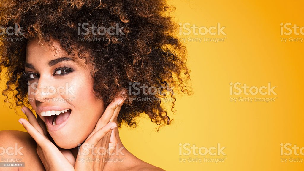 Beauty portrait of smiling girl with afro. stock photo