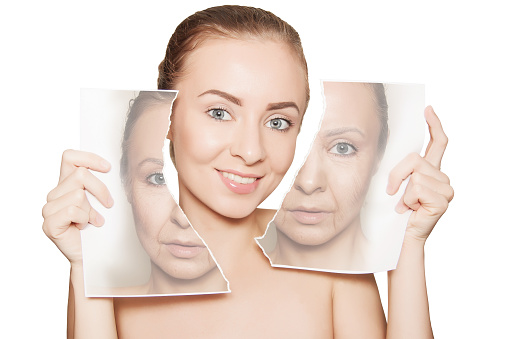 istock beauty portrait of woman breaking her old face photo 1128919988
