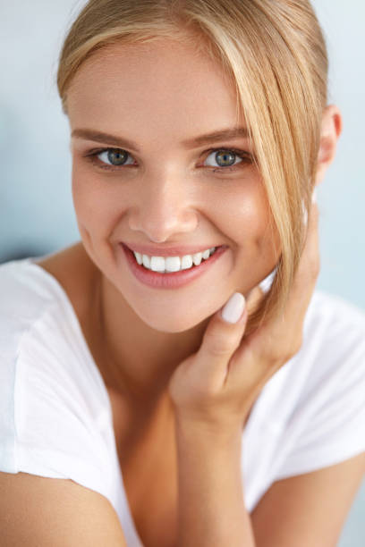 beauty portrait of woman with beautiful smile fresh face smiling - one young woman only stock pictures, royalty-free photos & images