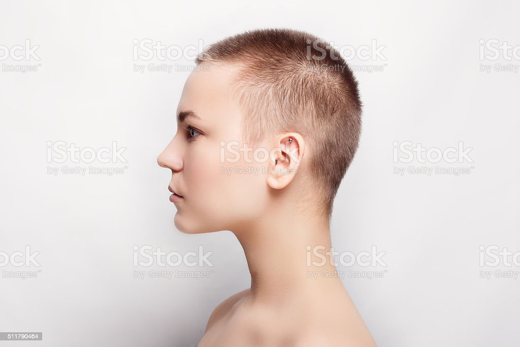 Beauty portrait of young girl profile with short hair stock photo