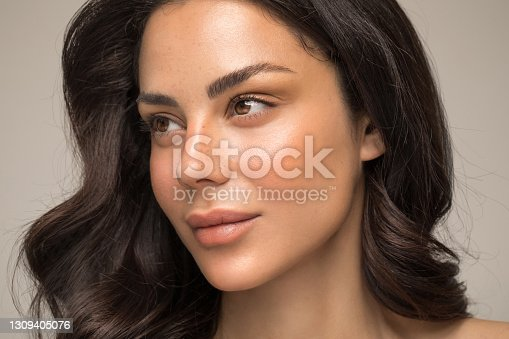 istock Beauty portrait of young woman 1309405076