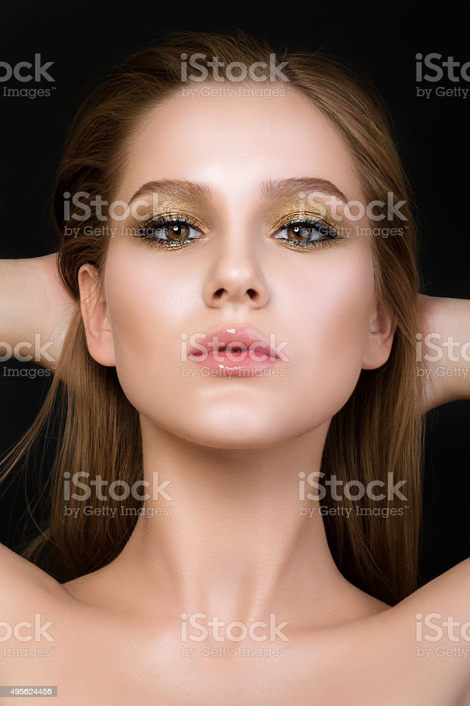 Beauty portrait of young woman with beautiful make-up stock photo