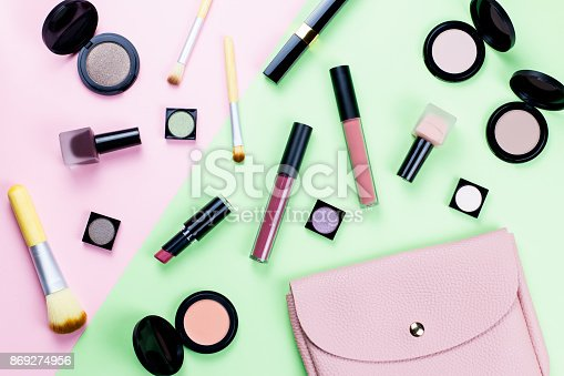 1078252566 istock photo Beauty products and fashion accessories flat lay on pastel background 869274956