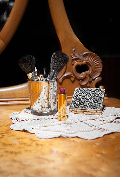 beauty products on vintage vanity - kellyjhall stock pictures, royalty-free photos & images