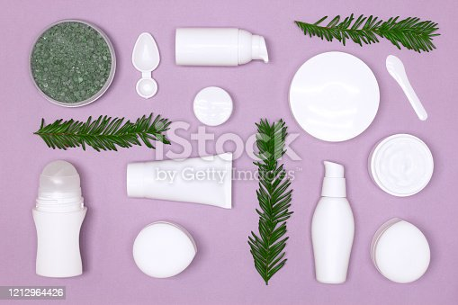 1128479585 istock photo Beauty products with green leaves layout. Natural organic skin care cosmetics flat lay 1212964426