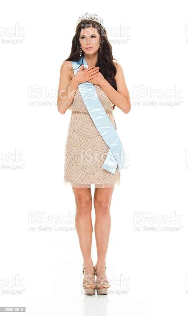 Beauty queen standing and looking away stock photo