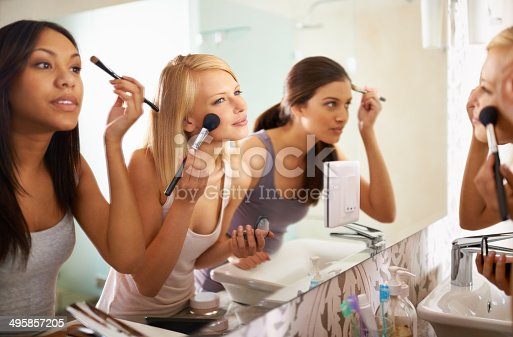 Shot of three friends applying makeup in front of the mirrorhttp://195.154.178.81/DATA/i_collage/pi/shoots/783430.jpg
