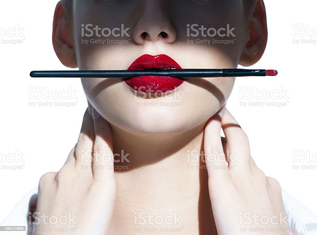 Beauty Red Lips Makeup Detail. Sensual Open Mouth. stock photo
