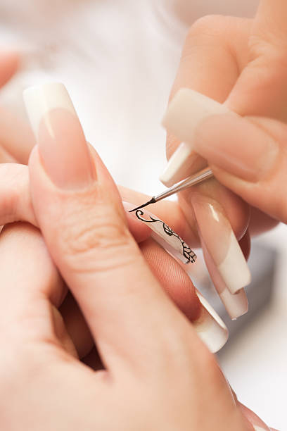 Beauty salon: Manicure, painting on nail stock photo