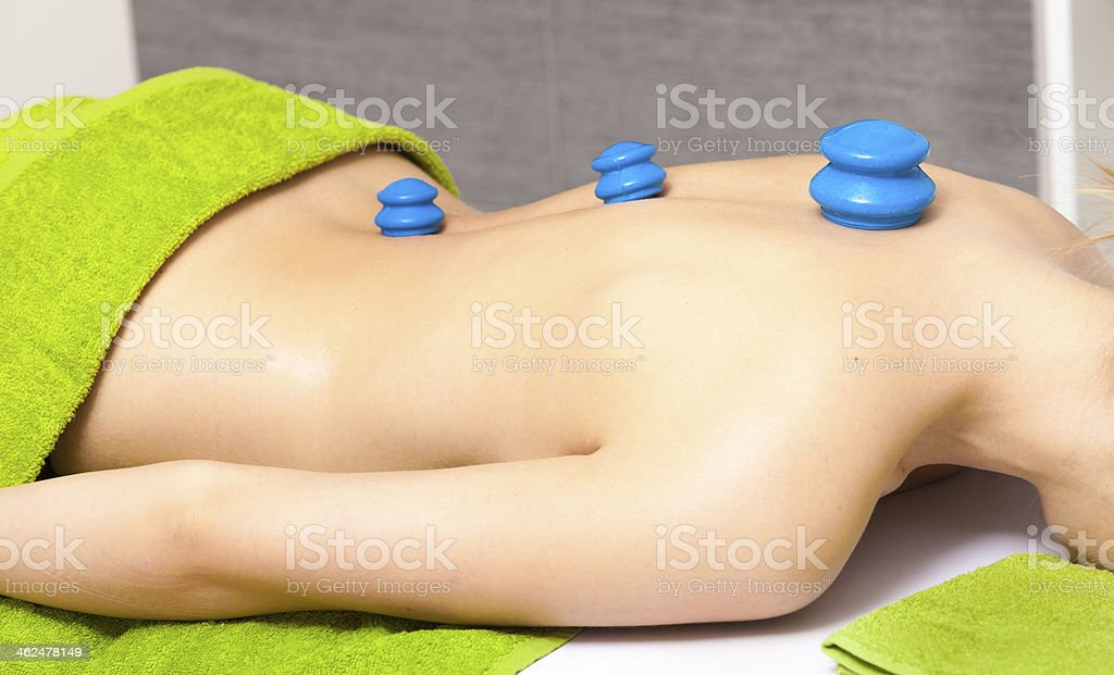 Beauty salon. Woman getting spa cupping glass vacuum massage stock photo