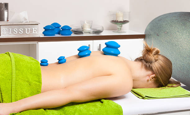 beauty salon. woman getting spa cupping glass vacuum massage - cupping therapy stock photos and pictures