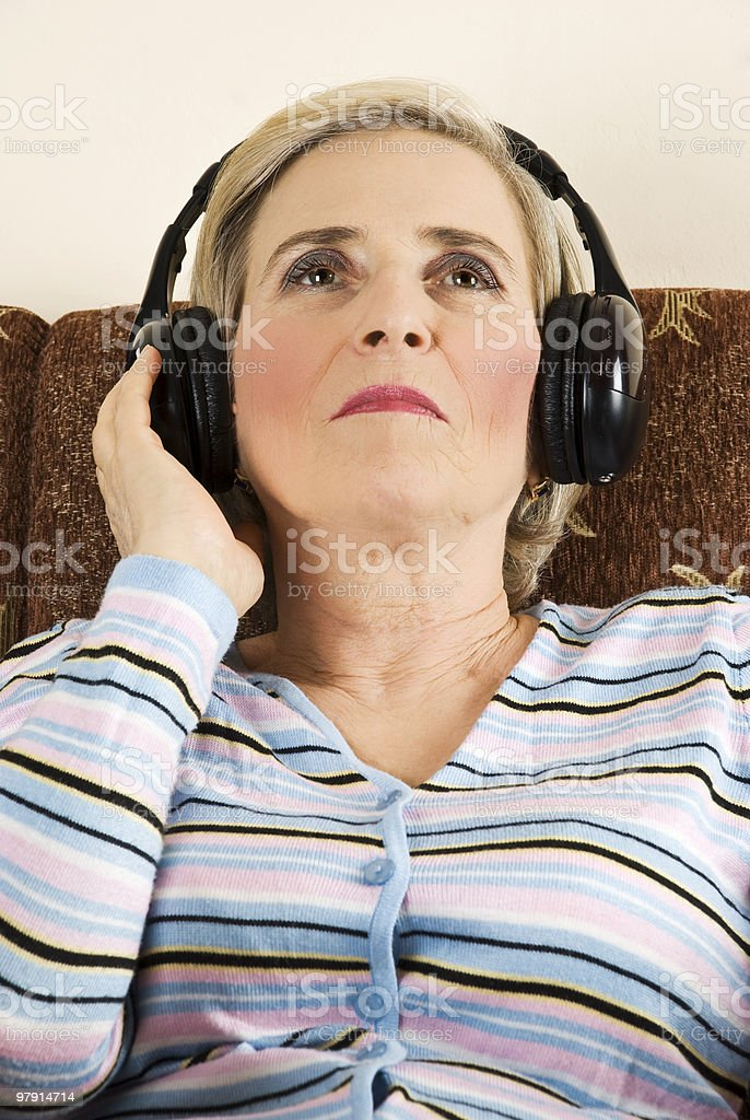 Beauty senior woman listen music royalty-free stock photo