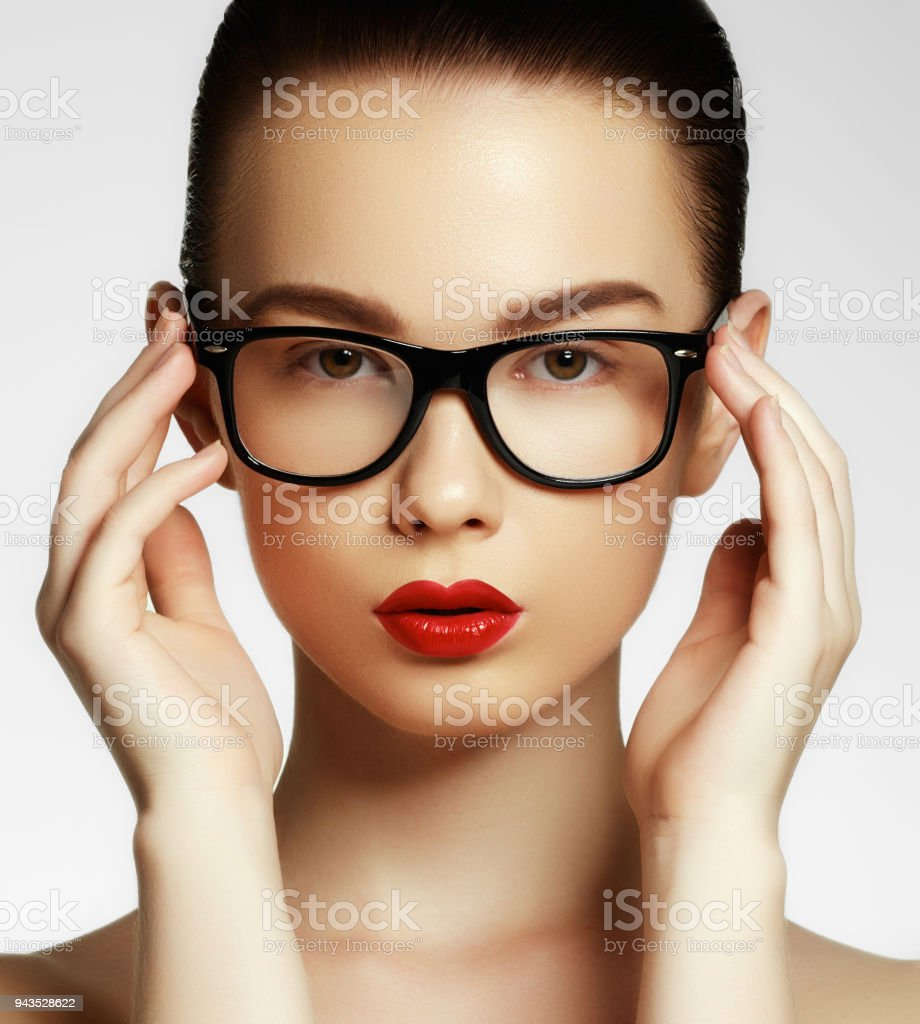 56c33c4a2 Beauty sexy fashion model girl wearing glasses, isolated on white background.  Beautiful young brunette