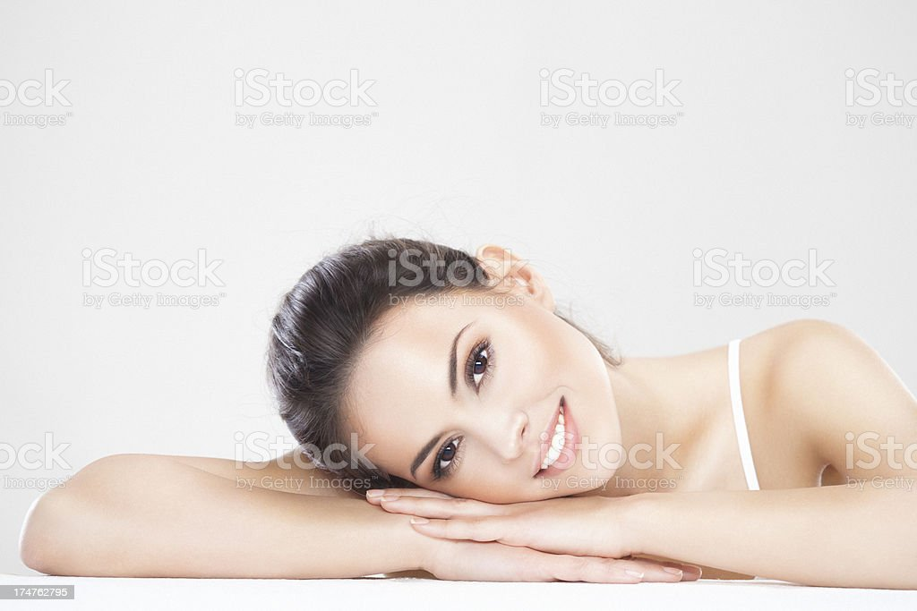 Beauty shot of a beautiful brunette woman relaxing at spa royalty-free stock photo