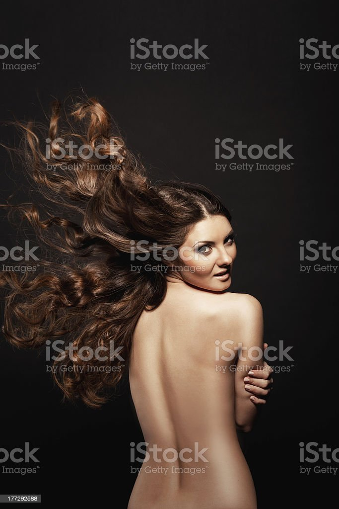 Beauty Shot of Beautiful Brunette Woman with Long Fluttering Hair royalty-free stock photo