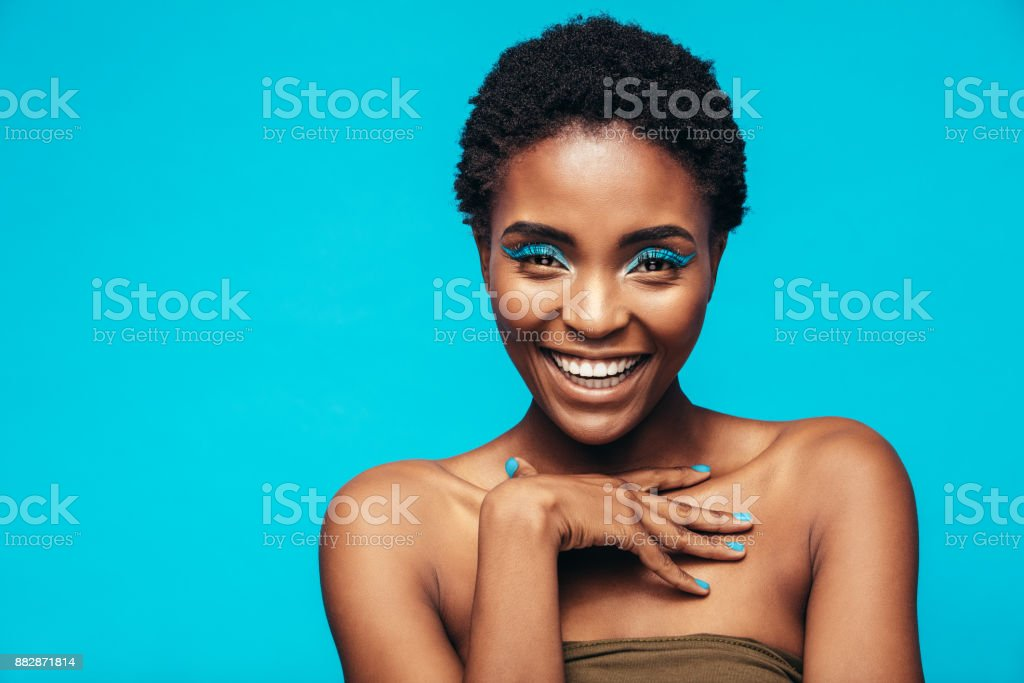 Beauty shot of woman with blue eye shadows stock photo